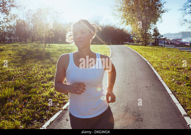 portrait of young running woman - Stock Image