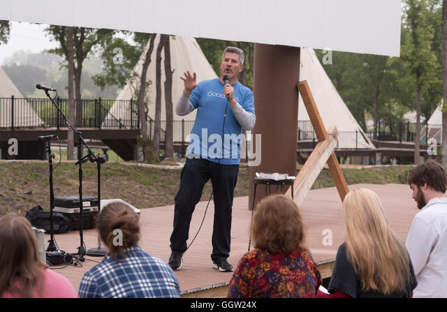 Minister conducts contemporary outdoor Easter service and interment ceremony at Community First! (CF) Village in - Stock Image
