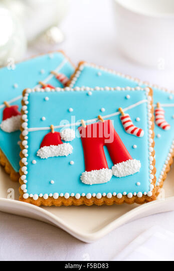 Plate of decorated Christmas cookies - Stock Image