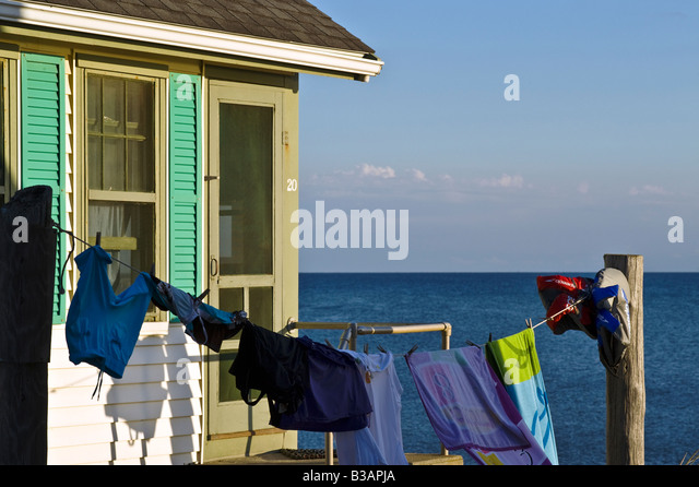 Waterfront beach cottage with clothes line, Truro, Cape Cod, MA - Stock Image