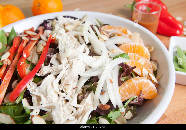 Entree sized Asian salad with chicken, bell peppers, tangerines, almonds, and much  more - Stock Image