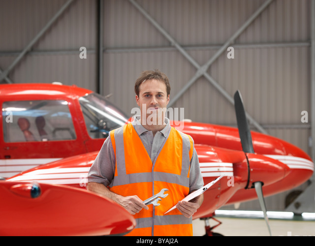 Engineer with turbo-prop aircraft - Stock Image