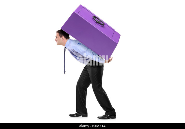 Person carrying a safe box on his back - Stock Image