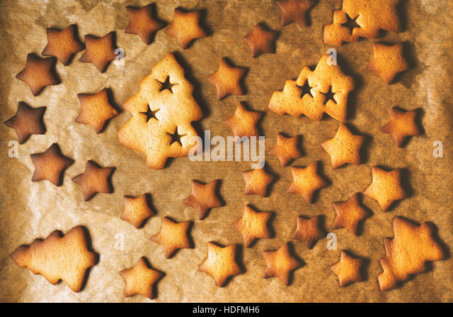Christmas cookies on the parchment top view - Stock Image