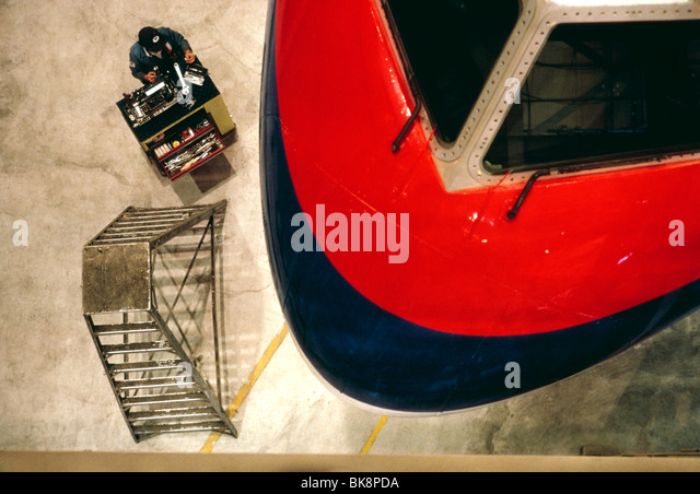 Overhead view of an aviation mechanic working on a jet at United Airlines maintenance facility in San Francisco, - Stock Image