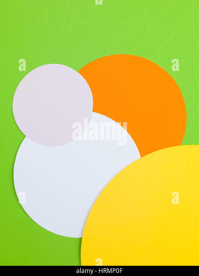 Illustration of Four Colored Circles Against a Green Background - Stock Image