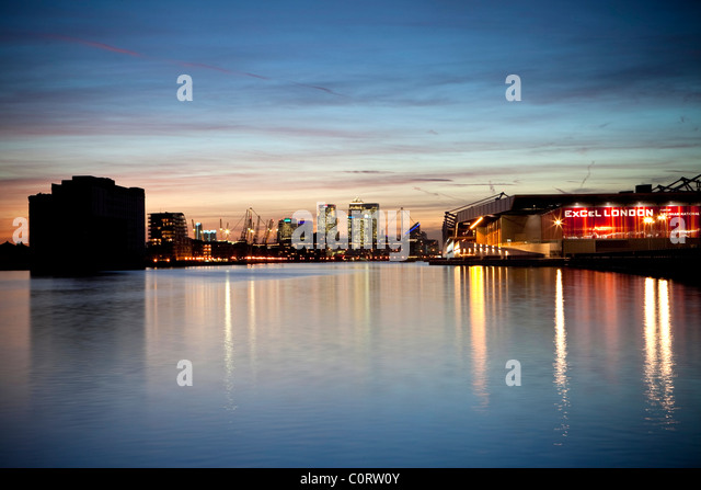 Isle of Dogs, Londons financial and the Excel Centre at dusk reflected in the waters of the Royal Victoria Dock - Stock Image