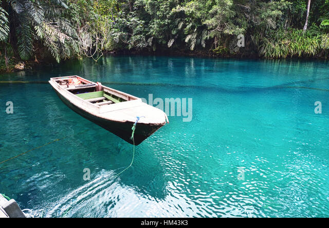 Floating boat on Labuan Cermin Lake - Stock Image