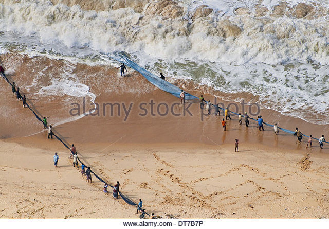 People pulling in net set for shorefishing Ghana An aerial view Ghana - Stock Image