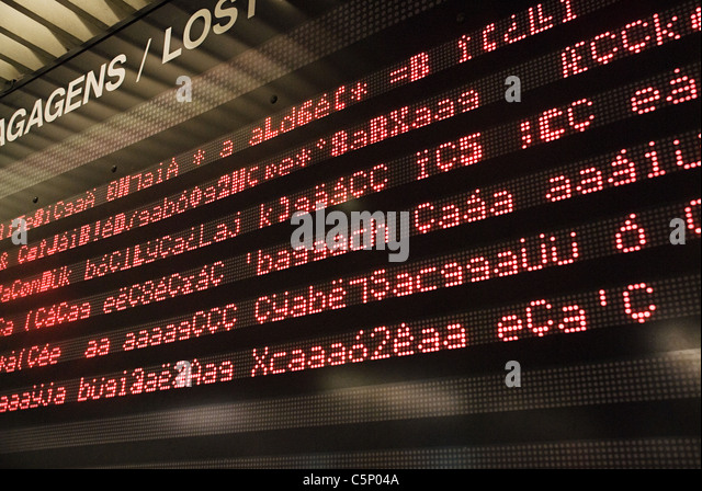 Broken information board in airport - Stock Image