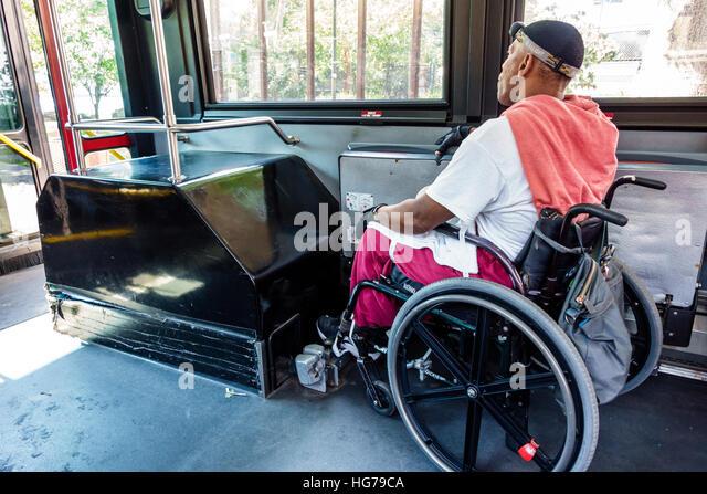 New York New York City NYC Roosevelt Island MTA public bus Black man wheelchair disabled rider - Stock Image