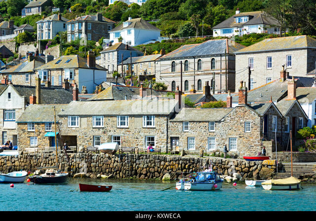 traditional stone cottages around the harbour at mousehole in cornwall, england, britain, uk. - Stock Image
