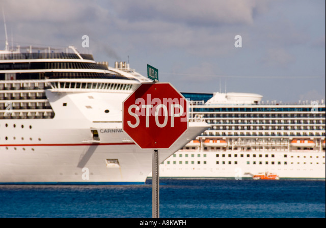 Grand Cayman George Town red stop sign irony humor - Stock Image