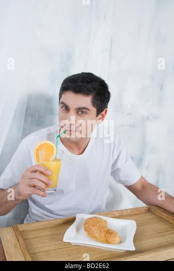 man eating breakfast - Stock-Bilder