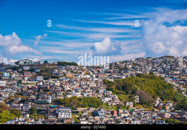Residential homes form the skyline of Nagasaki, Japan. - Stock Image