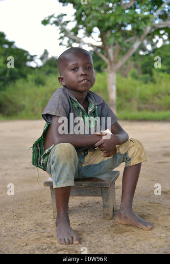 Boy sitting on a stool, Nkala, Bandundu Province, Democratic Republic of the Congo - Stock-Bilder