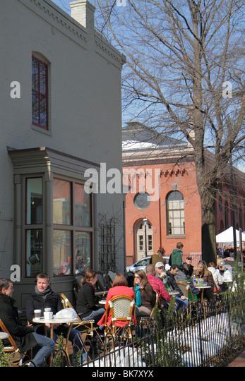 Washington DC Eastern Market 7th Street NE sidewalk cafe alfresco dining al fresco winter tables man woman groups - Stock Image