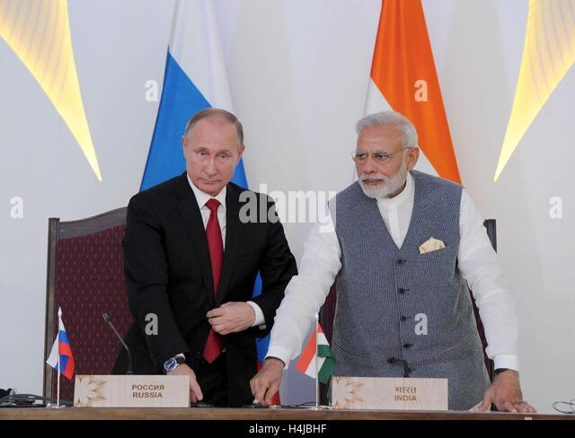 Indian Prime Minister Narendra Modi and Russian President Vladimir Putin push a button to begin the process of laying - Stock Image
