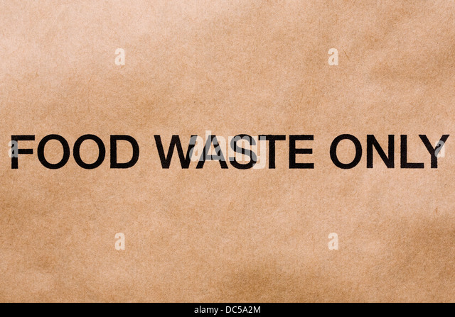 Food waste logo on a brown paper bag. - Stock Image