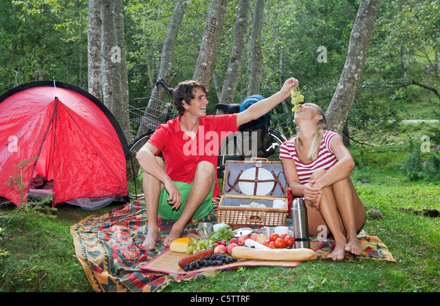 Austria, Salzburger Land, Couple having a picnic - Stock Image