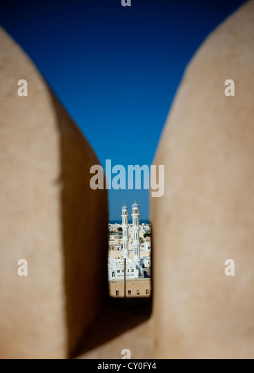 Minaret Viewed From The Wall Of Sineslah Fort, Sur, Oman - Stock Image