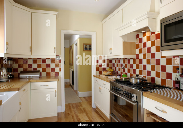 Interiors traditional kitchens neutral stock photos for Traditional kitchen wall tiles