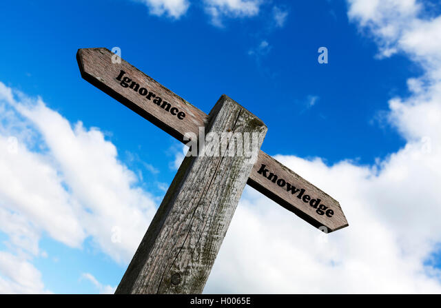 Ignorance knowledge concept sign choice choose life direction thick stupid or clever knowledgeable bright concepts - Stock Image