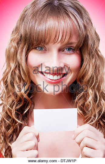 Female Brand Marketing Professional Displaying Blank Copyspace Business Card In A Company Self Promotion Concept - Stock Image