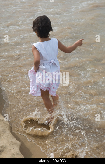 Girl walking on the beach Lebanon Middle East - Stock Image