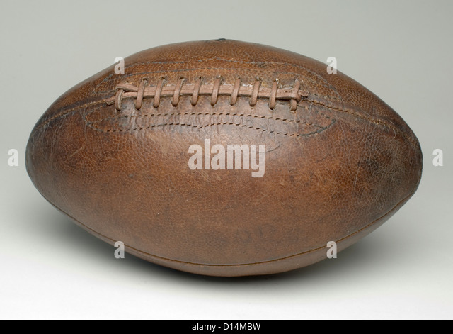 football on grey surface - Stock Image