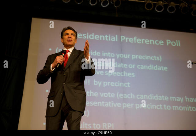 Republican presidential nominee candidate Rick Perry speaks at a caucus prior to voting in west Des Moines, Iowa - Stock Image