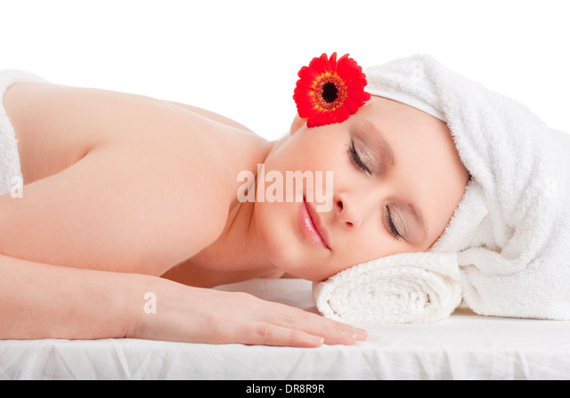 Young Woman in Spa Relaxing with her Eyes Closed - Stock Image