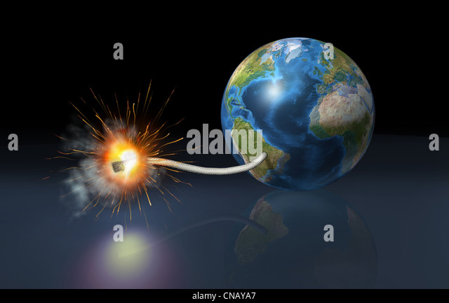 earth globe with a fuse lighted up as it is a bomb, on a reflective floor and dark background. - Stock Image