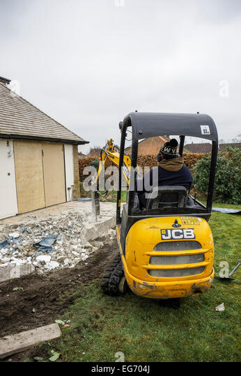 Smashing foundations to build a new extension on a home. Vertical format with copyspace. - Stock Image
