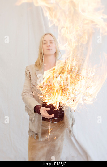 Woman with fire.  - Stock Image