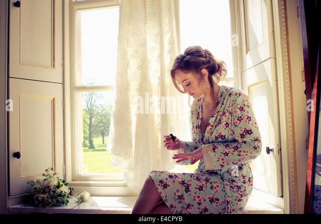 Wedding preparations, Woman painting fingernails, Dorset, England - Stock Image