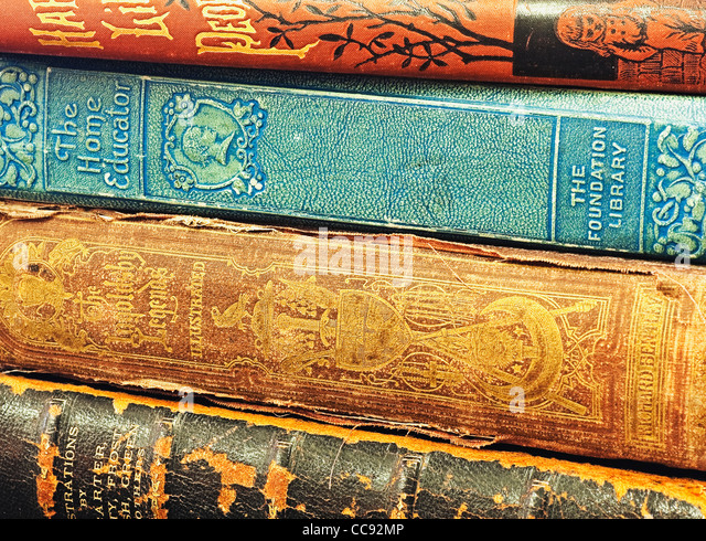 spines of stacked collection of books - Stock Image