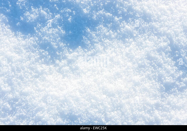 Snow in blue tone - texture or background - Stock Image