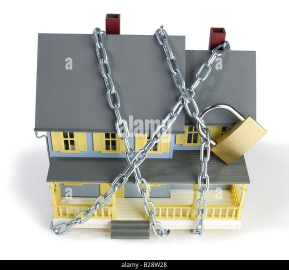 Chain and lock  around house - Stock Image
