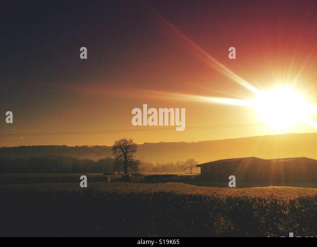 Sunset over fields - Stock Image