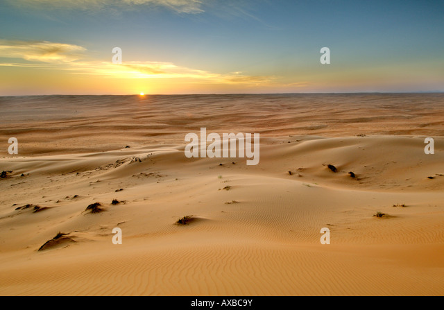 Sunset over Wahiba Sands (Ramlat al Wahaybah) in Oman. - Stock Image