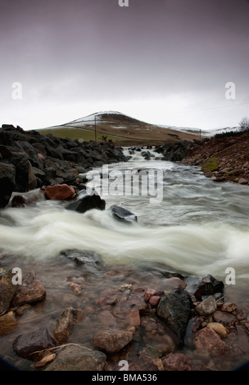 Scottish Borders, Scotland; A River Flowing Over Rocks - Stock Image