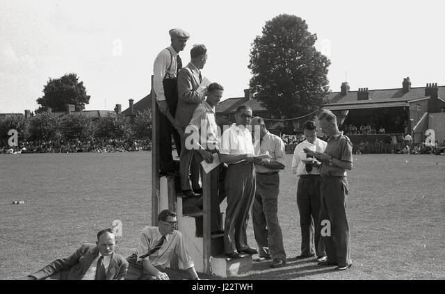 1950s, historical, timekeepers on a timekeeping stand at an outdoor amateur athletics meeting, England, UK. - Stock Image
