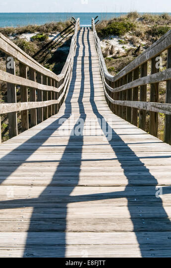 Boardwalk leading toward Atlantic Ocean - Stock Image