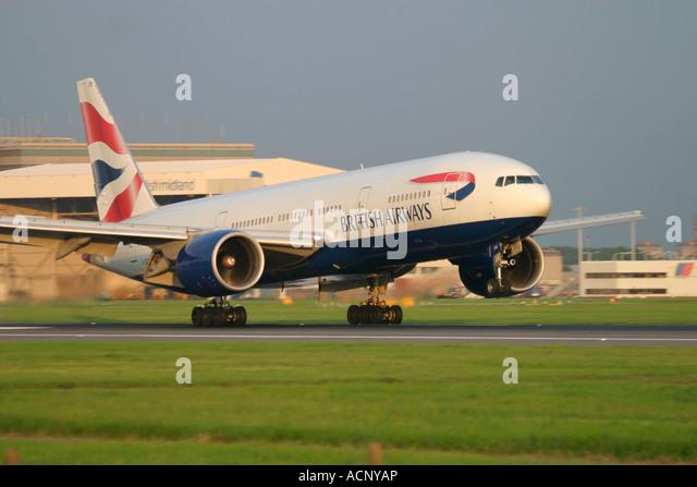 British Airways Boeing 777-236 touching down at London Heathrow Airport England UK - Stock Image