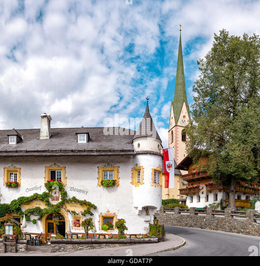 Virgen,Austria,Guesthouse Neuwirt and the church Heiliger Virgilius - Stock Image