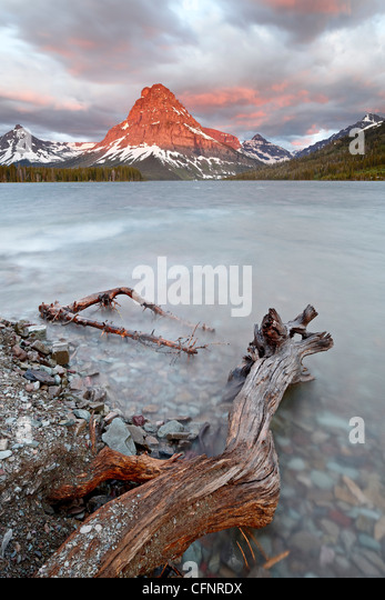 Sinopah Mountain and Pray Lake at sunrise, Glacier National Park, Montana, United States of America, North America - Stock Image