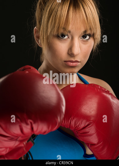 Female boxer with red boxing gloves. - Stock Image