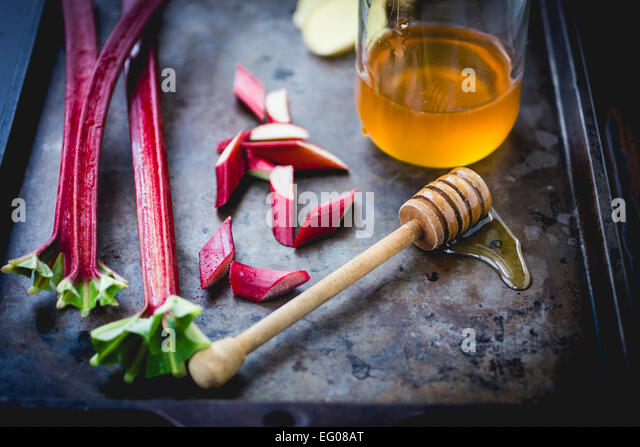 Rhubarb and honey cooking ingredients - Stock Image