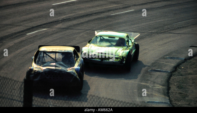 Two Race Cars Are Speeding Around The Racetrack